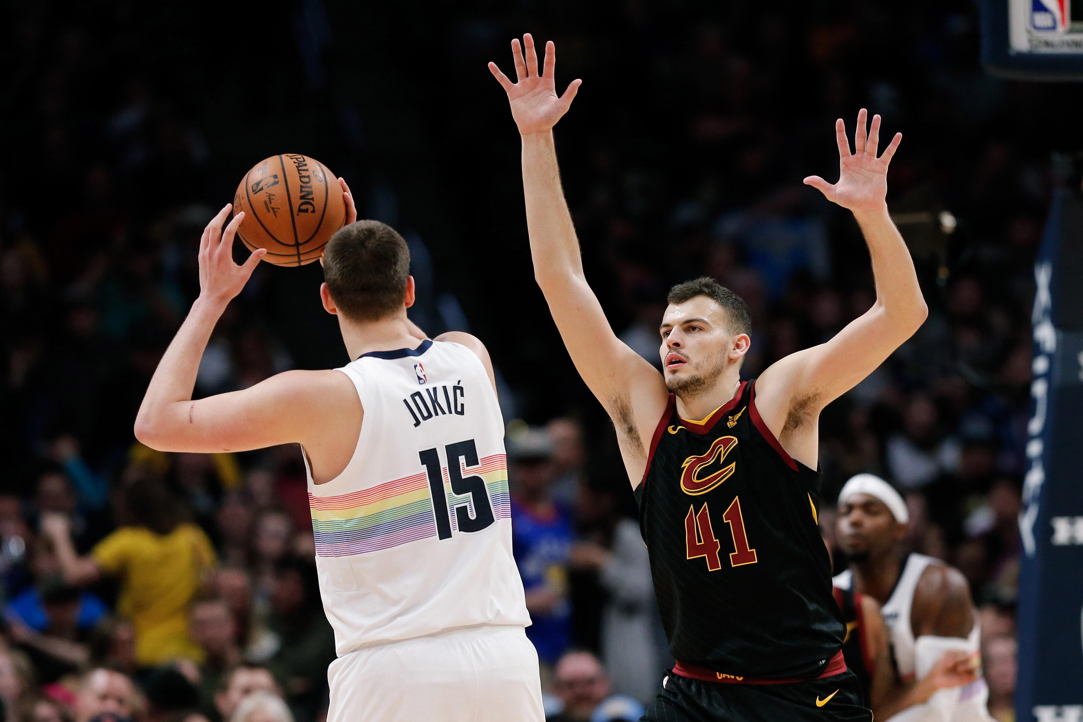 Cleveland Cavaliers center Ante Zizic (41) guards Denver Nuggets center Nikola Jokic (15) in the second quarter at the Pepsi Center.