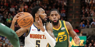 Denver Nuggets guard Will Barton (5) tries to get past Utah Jazz forward Royce O'Neale (23) and to the basket during the second quarter at Vivint Smart Home Arena.