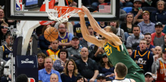 Utah Jazz center Rudy Gobert (27) dunks the basketball during the second quarter against the Denver Nuggets at Vivint Smart Home Arena.