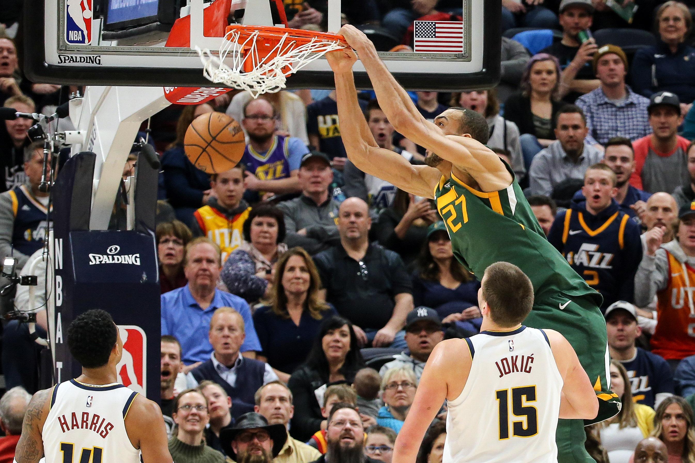 Utah Jazz center Rudy Gobert (27) dunks the basketball during the second quarter against the Denver Nuggets at Vivint Smart Home Arena.