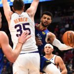 Denver Nuggets guard Jamal Murray (27) attempts a pass behind Phoenix Suns forward Dragan Bender (35) in the second quarter at the Pepsi Center.