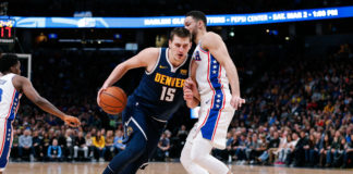 Denver Nuggets center Nikola Jokic (15) drives against Philadelphia 76ers guard Ben Simmons (25) in the first quarter at the Pepsi Center.