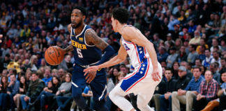 Denver Nuggets guard Will Barton (5) dribbles the ball against Philadelphia 76ers guard Landry Shamet (1) in the second quarter at the Pepsi Center.