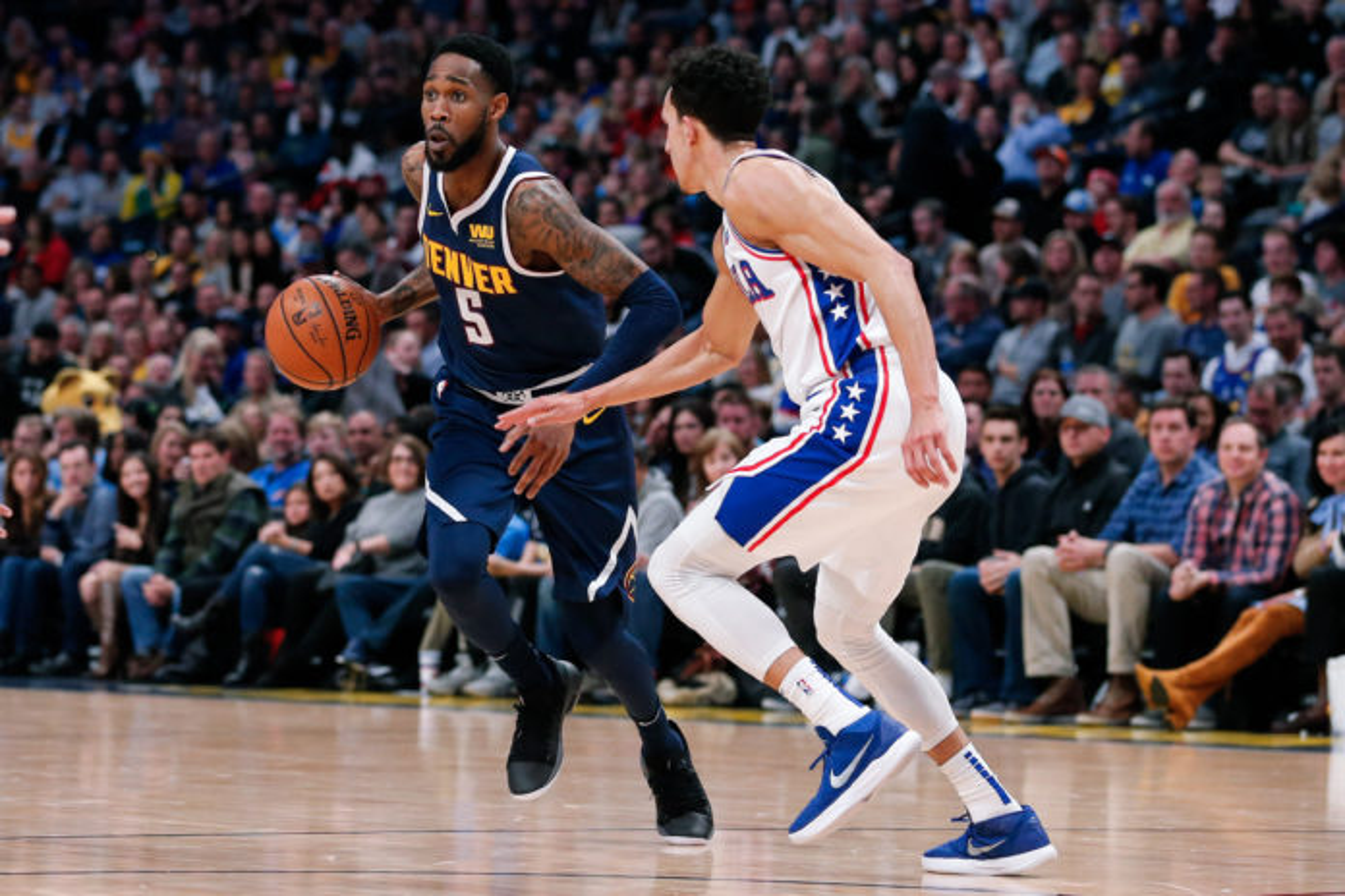 Denver Nuggets guard Will Barton (5) dribbles the ball against Philadelphia 76ers guard Landry Shamet (1) in the second quarter at the Pepsi Center.