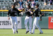 Colorado Rockies left fielder Ian Desmond (20) and center fielder Charlie Blackmon (19) and right fielder David Dahl (26) celebrate after the game against the San Diego Padres at Coors Field. Mandatory Credit: Isaia