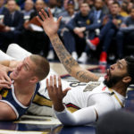 Denver Nuggets forward Mason Plumlee (24) and New Orleans Pelicans forward Anthony Davis (23) wait for a foul call in the second half at the Smoothie King Center. Davis was called for the foul.