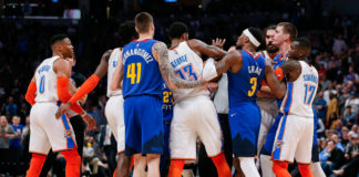 Denver Nuggets and Oklahoma City Thunder players shove each other after an altercation in the fourth quarter at the Pepsi Center.