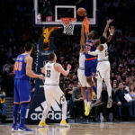 New York Knicks forward Noah Vonleh (32) dunks the ball against Denver Nuggets forward Trey Lyles (7) and guard Malik Beasley (25) as center Nikola Jokic (15) and Knicks center Enes Kanter (00) look on in the second quarter at the Pepsi Center.