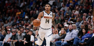 Denver Nuggets guard Gary Harris (14) dribbles the ball up court in the second quarter against the New York Knicks at the Pepsi Center.