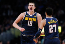 Denver Nuggets center Nikola Jokic (15) reacts with guard Jamal Murray (27) after a play in the third quarter against the Los Angeles Clippers at the Pepsi Center.