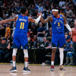 Denver Nuggets forward Torrey Craig (3) celebrates with guard Monte Morris (11) after a play in the third quarter against the Houston Rockets at the Pepsi Center.
