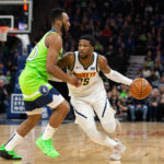 Denver Nuggets guard Malik Beasley (25) dribbles the ball as Minnesota Timberwolves guard Josh Okogie (20) guards him during the first quarter at Target Center.
