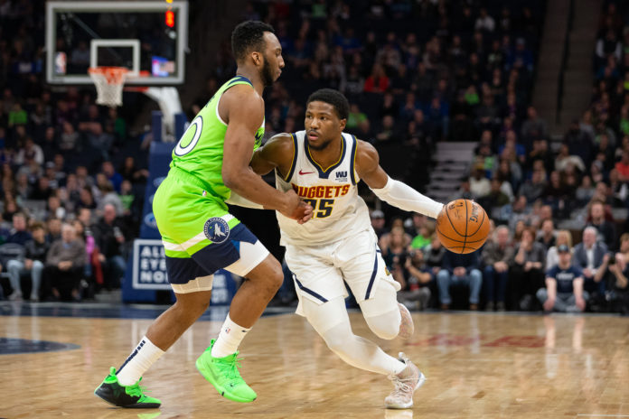 Denver Nuggets guard Malik Beasley (25) dribbles the ball as Minnesota Timberwolves guard Josh Okogie (20) guards him during the first quarter at Target Center.