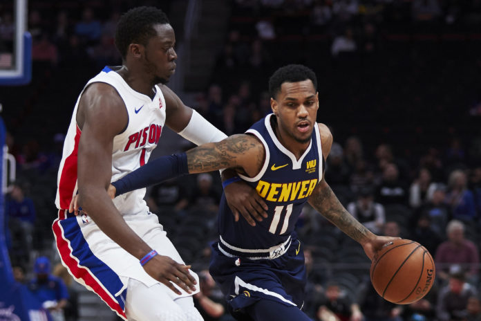 39f87c0f7 Denver Nuggets guard Monte Morris (11) dribbles the ball defended by  Detroit Pistons guard