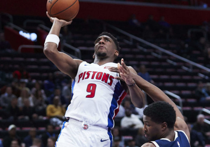 Detroit Pistons guard Langston Galloway (9) charges into Denver Nuggets guard Malik Beasley (25) in the second half at Little Caesars Arena.