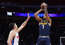 Denver Nuggets forward Trey Lyles (7) shoots over Detroit Pistons center Zaza Pachulia (27) in the first half at Little Caesars Arena.