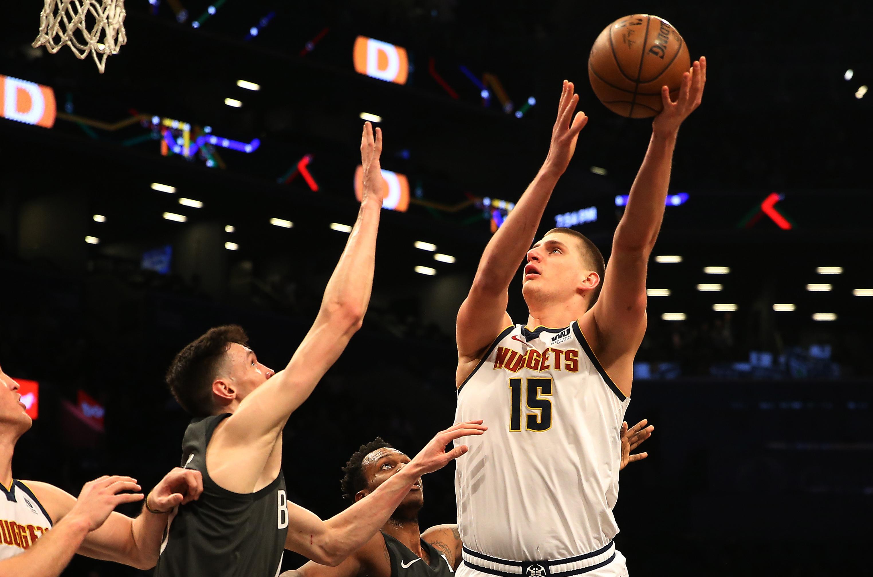 Denver Nuggets center Nikola Jokic (15) shoots against Brooklyn Nets forward Rodions Kurucs (00) during the first half at Barclays Center.