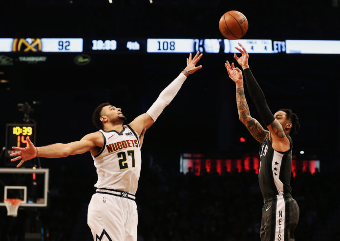 Brooklyn, NY, USA; Brooklyn Nets guard D'Angelo Russell (1) shoots against Denver Nuggets guard Jamal Murray (27) during the second half at Barclays Center.