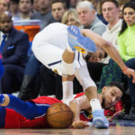 Philadelphia 76ers guard Ben Simmons (25) battles for the ball with Denver Nuggets guard Jamal Murray (27) during the first quarter at Wells Fargo Center.