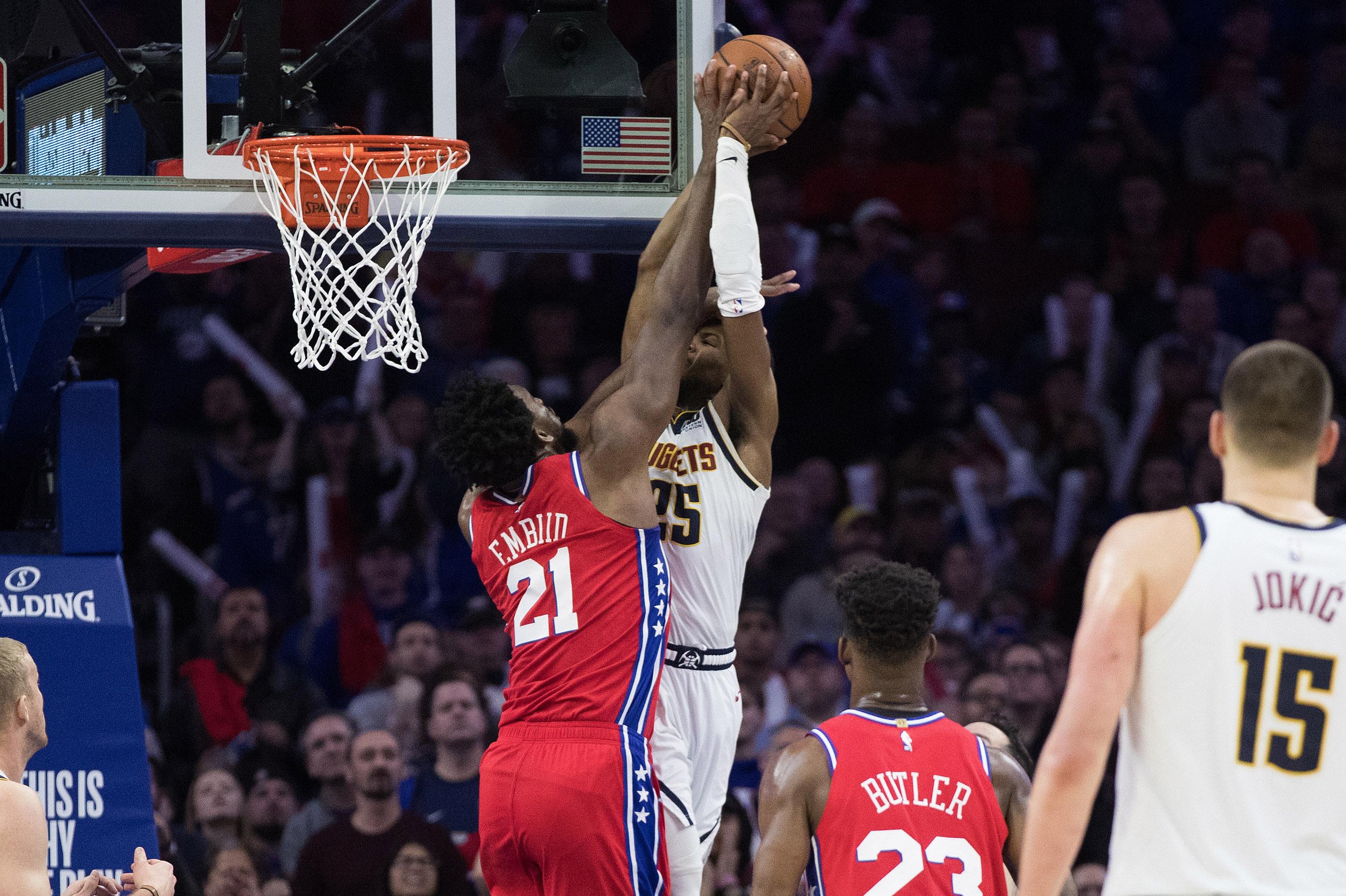 Philadelphia, PA, USA; Philadelphia 76ers center Joel Embiid (21) blocks the shot of Denver Nuggets guard Malik Beasley (25) during the fourth quarter at Wells Fargo Center.