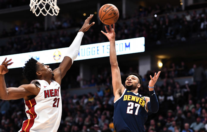 Denver Nuggets guard Jamal Murray (27) shoots over Miami Heat center Hassan Whiteside (21) in the second quarter at the Pepsi Center.