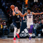 Denver Nuggets center Nikola Jokic (15) passes the ball as Sacramento Kings forward Marvin Bagley III (35) defends in the second quarter at the Pepsi Center.