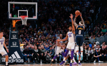 Denver, CO, USA; Sacramento Kings forward Marvin Bagley III (35) defends on a shot from Denver Nuggets guard Isaiah Thomas (0) in the third quarter at the Pepsi Center.