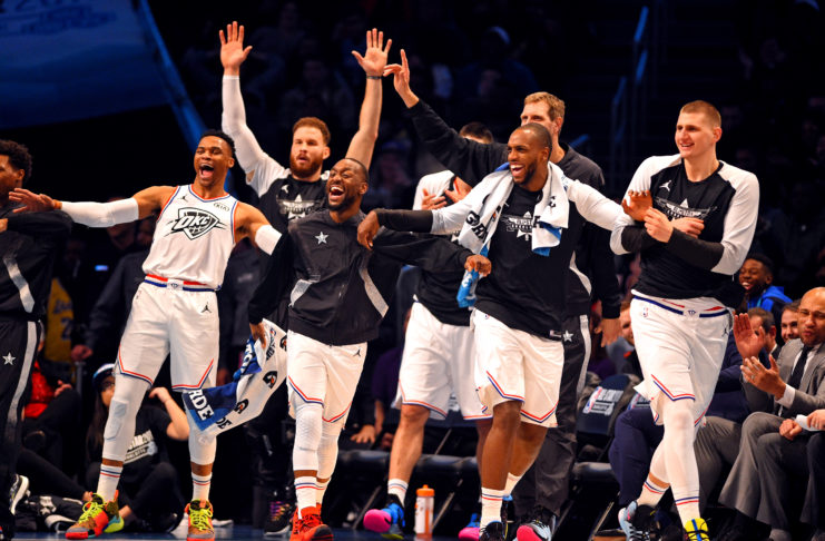 Team Giannis guard Russell Westbrook of the Oklahoma City Thunder (0), Team Giannis guard Kemba Walker of the Charlotte Hornets (15), Team Giannis forward Khris Middleton of the Milwaukee Bucks (22) and Team Giannis center Nikola Jokic of the Denver Nuggets (15) react on the bench during the 2019 NBA All-Star Game at Spectrum Center