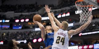 Denver Nuggets guard Will Barton (5) and forward Mason Plumlee (24) defend against Dallas Mavericks forward Dwight Powell (7) during second quarter at the American Airlines Center.