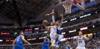 Denver Nuggets guard Gary Harris (14) drives to the basket past Dallas Mavericks forward Maximilian Kleber (42) and forward Dwight Powell (7) and forward Dorian Finney-Smith (10) during second half at the American Airlines Center.