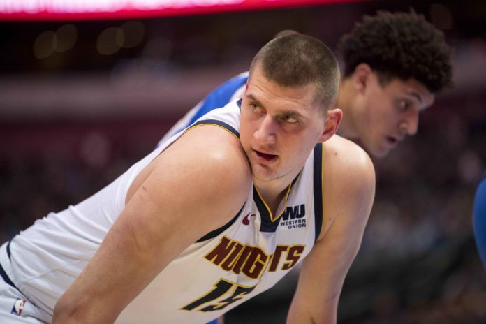 Denver Nuggets center Nikola Jokic (15) exchanges words with the Dallas Mavericks bench during second half at the American Airlines Center.