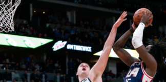 Los Angeles Clippers forward Johnathan Motley (15) shoots against Denver Nuggets center Nikola Jokic (15) in the fourth quarter at the Pepsi Center.