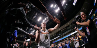 Denver Nuggets center Nikola Jokic (15) hi-fives fans after the game against the Oklahoma City Thunder at the Pepsi Center.