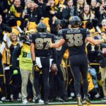 Iowa Hawkeyes tight end Noah Fant (87) celebrates his second touchdown reception during the second quarter against the Ohio State Buckeyes at Kinnick Stadium.