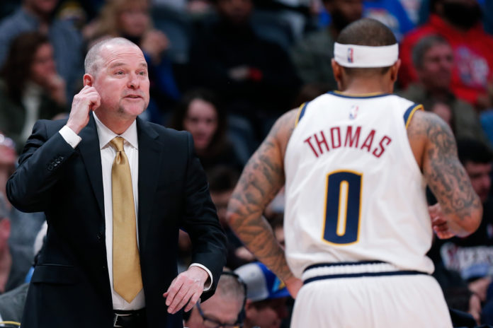 Denver Nuggets head coach Michael Malone talks with guard Isaiah Thomas (0) in the fourth quarter against the Los Angeles Clippers at the Pepsi Center.