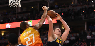 Denver Nuggets center Nikola Jokic (15) attempts a shot past Utah Jazz center Rudy Gobert (27) in the second half at the Pepsi Center.