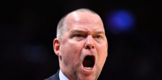 Denver Nuggets head coach Michael Malone reacts to a foul called in the second half against the Utah Jazz at the Pepsi Center.