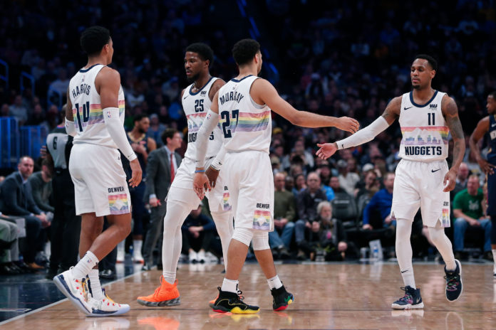 Denver Nuggets guard Gary Harris (14) and guard Jamal Murray (27) come onto the court for guard Malik Beasley (25) and guard Monte Morris (11) in the fourth quarter against the New Orleans Pelicans at the Pepsi Center.