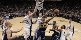 Denver Nuggets point guard Isaiah Thomas (0) has his shot blocked by San Antonio Spurs point guard Derrick White (4) during the second half at AT&T Center.