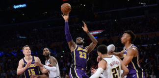 Los Angeles Lakers forward LeBron James (23) moves to the basket against Denver Nuggets guard Jamal Murray (27) during the second half at Staples Center.