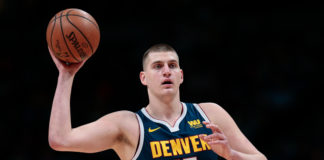 Denver Nuggets center Nikola Jokic (15) controls the ball in the first quarter against the Dallas Mavericks at the Pepsi Center.