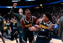 Denver Nuggets forward Paul Millsap (4) and guard Gary Harris (14) react after the game against the Dallas Mavericks at the Pepsi Center.
