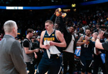 Denver Nuggets center Nikola Jokic (15) gets showered with water after the game against the Dallas Mavericks at the Pepsi Center.