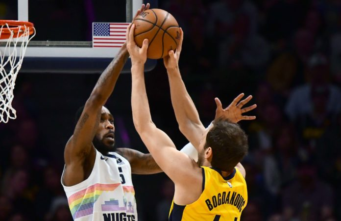 Denver Nuggets guard Will Barton (5) blocks a shot attempt by Indiana Pacers forward Bojan Bogdanovic (44) in the first quarter at the Pepsi Center.