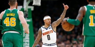 Denver Nuggets point guard Isaiah Thomas (0) signals to the bench during the first half against the Boston Celtics at TD Garden.