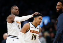 Denver Nuggets center Paul Millsap (4) and guard Gary Harris (14) celebrate during the second half against the Boston Celtics at TD Garden.