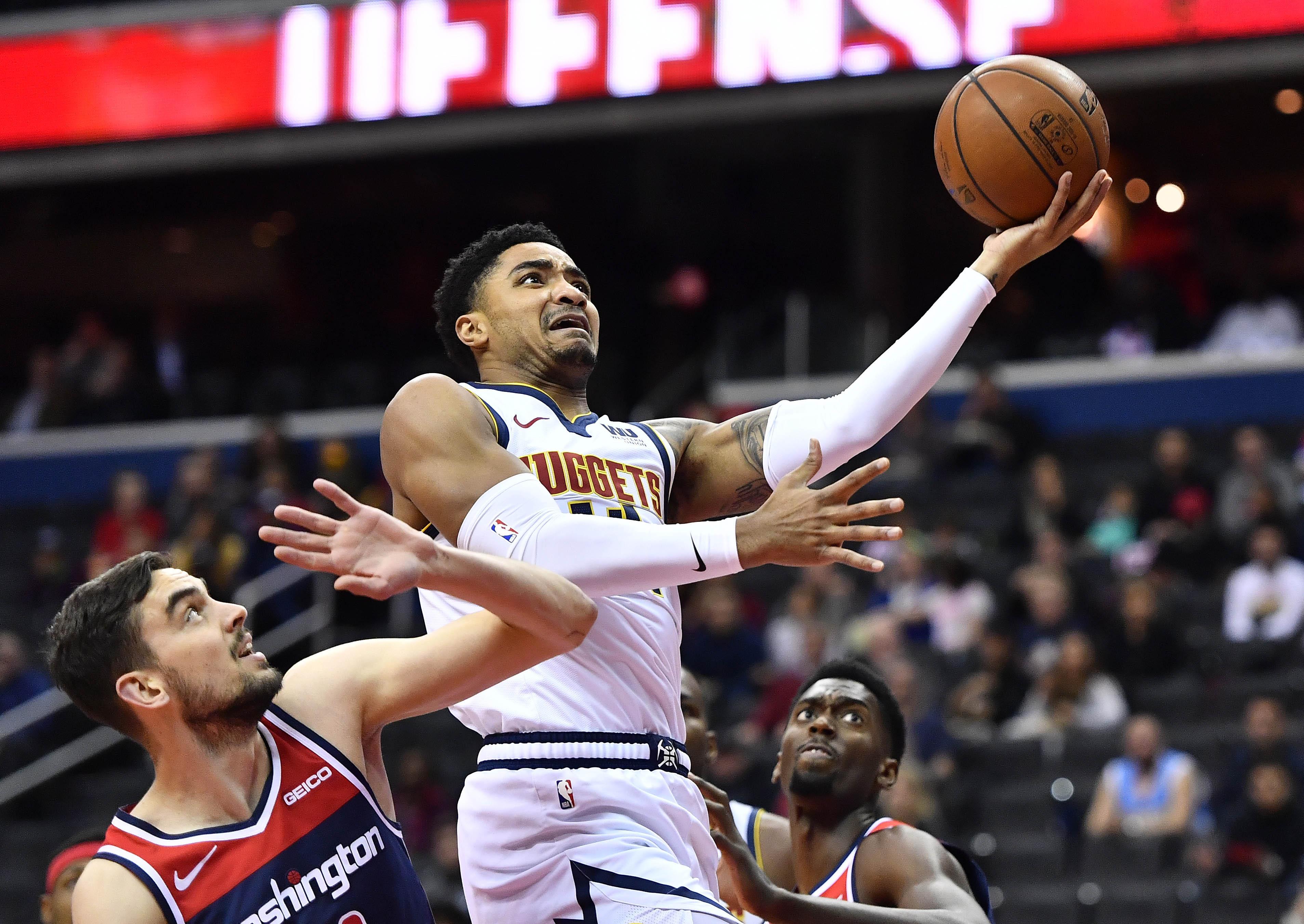 Denver Nuggets guard Gary Harris (14) shoots over Washington Wizards guard Tomas Satoransky (31) during the first half at Capital One Arena