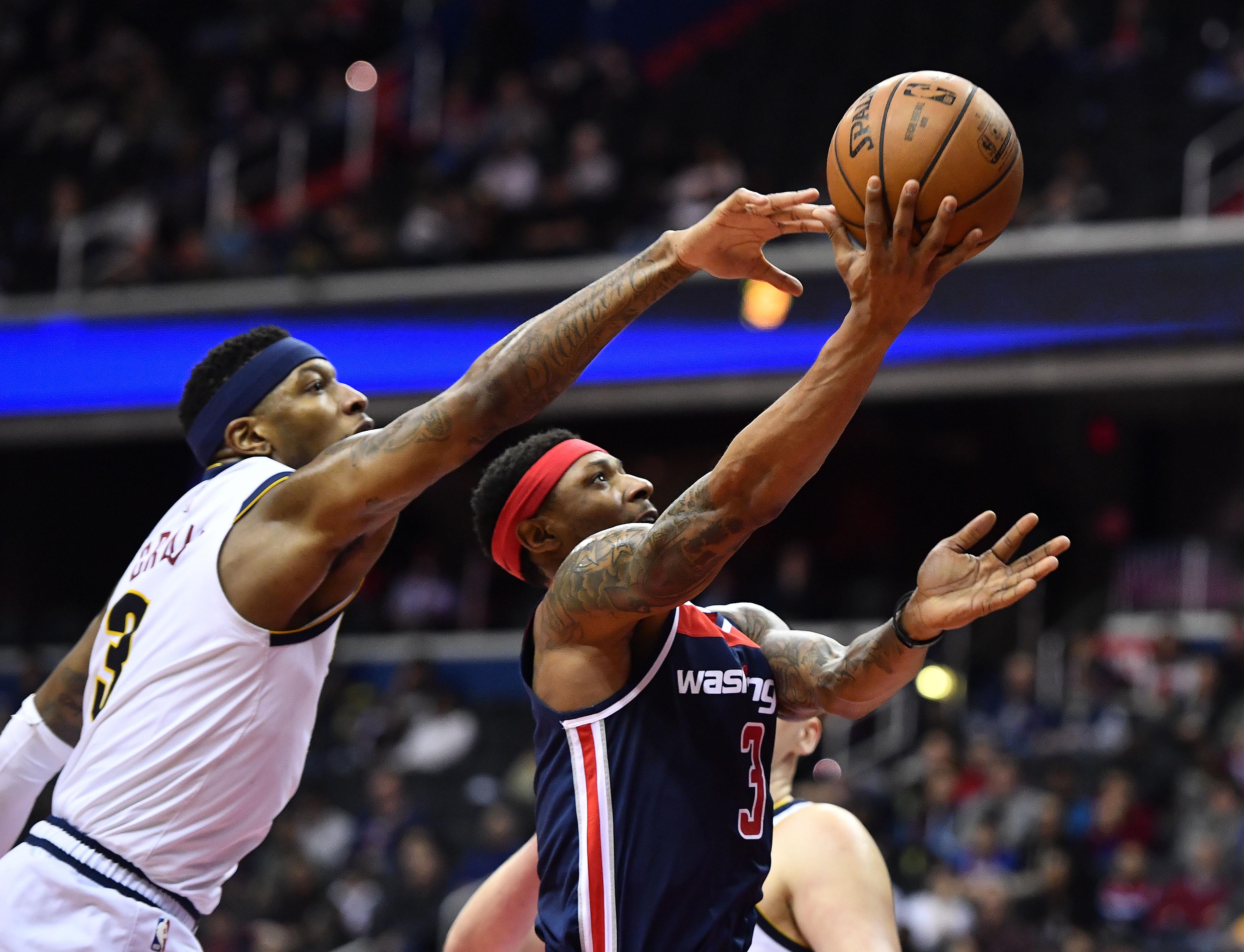 Washington, DC, USA; Washington Wizards guard Bradley Beal (3) shoots as Denver Nuggets forward Torrey Craig (3) defends during the second half at Capital One Arena.