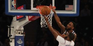 Denver Nuggets shooting guard Will Barton (5) blocks a shot by New York Knicks point guard Emmanuel Mudiay (1) during the first quarter at Madison Square Garden.