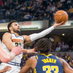Denver Nuggets guard Jamal Murray (27) shoots the ball in the first quarter against the Indiana Pacers at Bankers Life Fieldhouse.